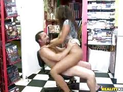 Giselle riding hunter reverse cowgirl style in her video store