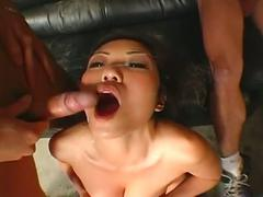 Asian gets two cocks to suck and gets messy facial