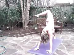 Bysty girl doing naked yoga in the backyard