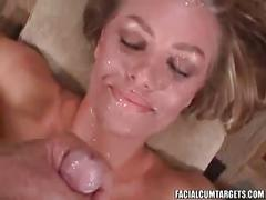 Blonde babe sucks on a big cock and takes cum on face
