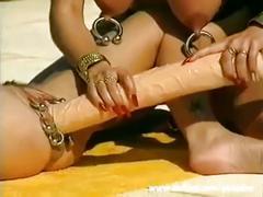 Youporn - busty bizarre babe fucks a gigantic dildo outdoors