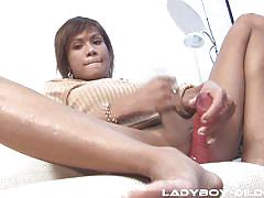 Stuffing her hole with a dildo