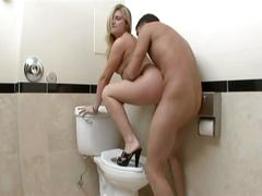 Nasty blonde babe serving huge cock in bathroom