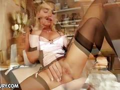 Horny blonde in black stockings solo pussy show