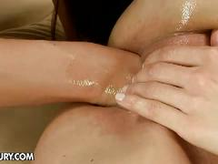Lovely brunette lesbian gets fist in her pussy