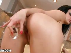 Busty brunette playing pussy in the kitchen