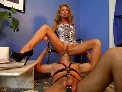 Sexy mistress humiliates her slave