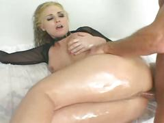 Horny blonde babe fucked by two guys in a prision cell