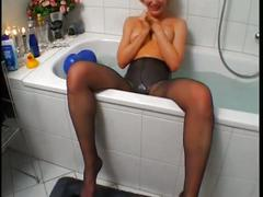 Pantyhose girl in the tub