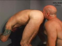 Horny police bear getting huge throbbing cock sucked by prisoner