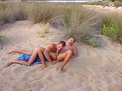 Horny dude sucking his lover's cock in the beach