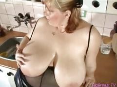 Chubby blonde fucks with dildo