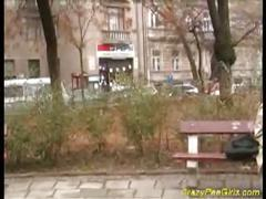 Horny brunette peeing and playing pussy in public
