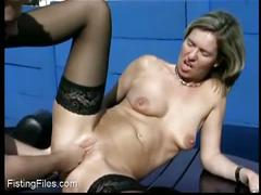 Horny blonde mom gets fisted outside
