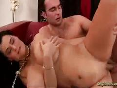 Busty brunette bangs and blows his cock