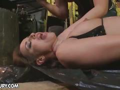 Mistress plugs dark dildo inside her slave