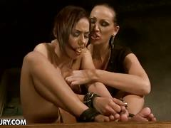 Horny mistress tortures brunette slave with toys