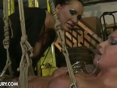 Fierce lesbian mistress playing hard with slave