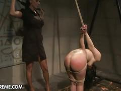 Horny brunette slave for fierce lesbian mistress