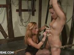 Hot mistress puts red dildo up the slave's pussy