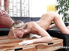 Dirty blonde babe cleans a table covered in piss clean with her tongue