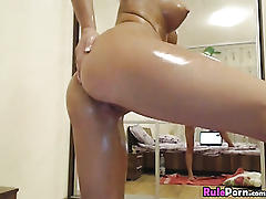 Oiled busty girlfriend posing on cam