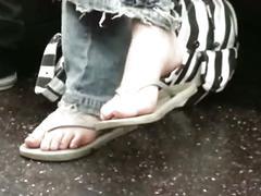 Candid nerdy teen flip-flop feet shoeplay on bus