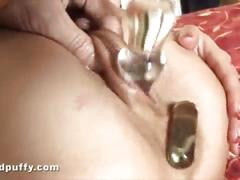 Dark haired babe enjoys a pussy pump on her low hanging labia