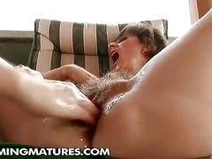 Young bitch fisting a mature hairy pussy