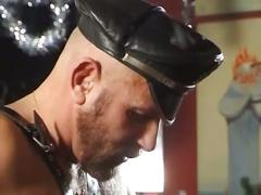 These two big dudes wearing leather enjoy hot sex at the bar