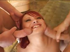 Redhead takes on two large cocks in all holes
