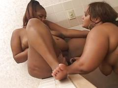Two huge ebony lesbian babes get to eating pussy