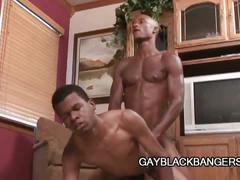 Two ebony studs enjoying some gay love