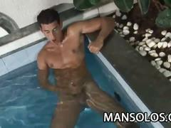 Hot stud playing with his cock in the pool