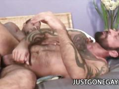 Tattooed dude loves a beefy black dude's cock