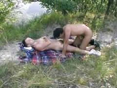 Twinks in an open-air blowjob scene