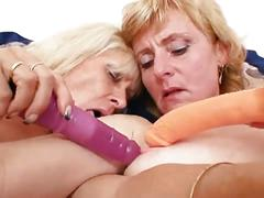 Nasty blonde lesbian grannies in stockings playing together