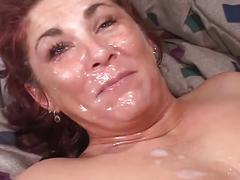 Horny mature sucking and fucking two cocks