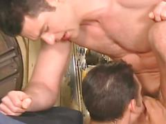 Fervent threesome coition as muscled studs in factory pound hard