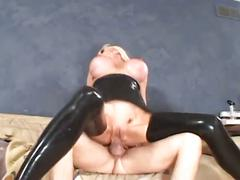 Sexy blonde babe in black latex gets huge tits into the action