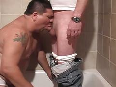 Lewd fatty dad taking huge cock down his throat in bathtub