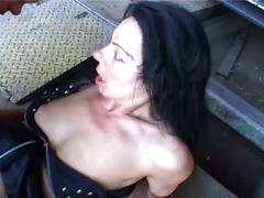 Sexy brunette milf gets double cock action in the garage