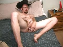 Sexy amateur cowboy toys ass and strokes cock
