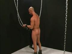 Muscled daddy solo and jerking his horny manhood while in chains