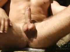 Sexy beefy young hunk strokes cock outside