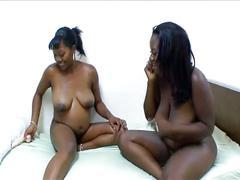 Busty lesbian gives pregnant ebony a dildo exam