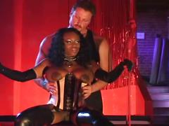 Busty ebony in latex gets a big white cock in her ass