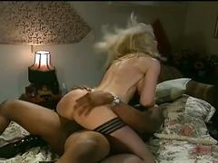Busty blonde meets two black cocks in a hotel