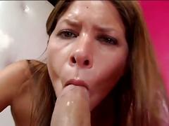 Busty brunette sucks big cock and spits on lens
