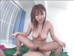 Lusty asian babe deepthroats a big hard cock